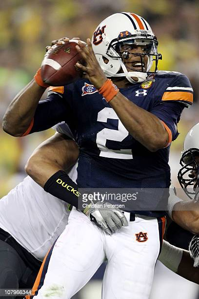 Quarterback Cameron Newton of the Auburn Tigers is sacked by Zac Clark of the Oregon Ducks in the first quarter during the Tostitos BCS National...