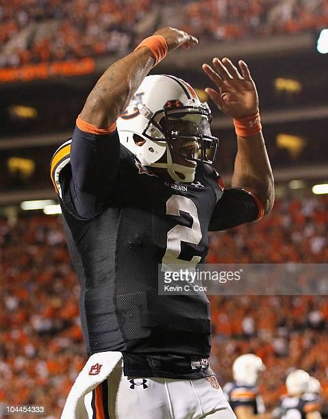Quarterback Cameron Newton of the Auburn Tigers reacts after passing for a touchdown against the South Carolina Gamecocks at JordanHare Stadium on...