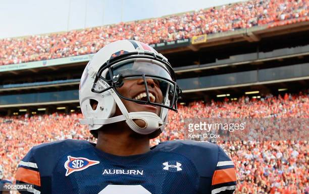 Quarterback Cameron Newton of the Auburn Tigers runs around after pregame warmups before facing the Georgia Bulldogs at JordanHare Stadium on...