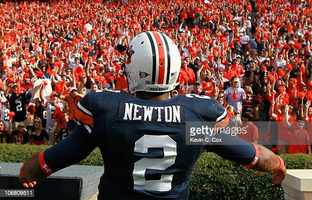 Quarterback Cameron Newton of the Auburn Tigers runs around during pregame warmups before facing the Georgia Bulldogs at JordanHare Stadium on...