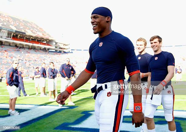 Quarterback Cameron Newton of the Auburn Tigers walks off the field after a pregame walkthrough before facing the Georgia Bulldogs at JordanHare...