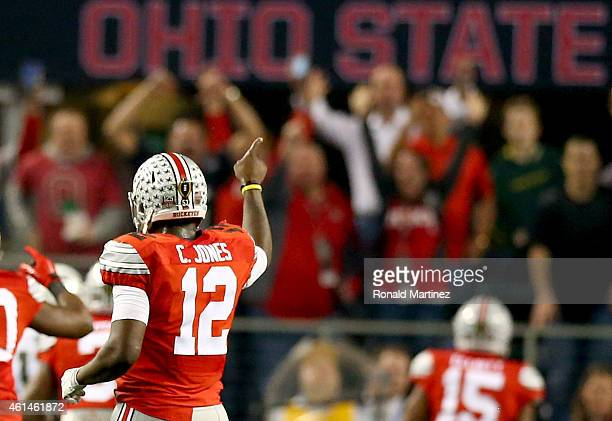 Quarterback Cardale Jones celebrates as running back Ezekiel Elliott of the Ohio State Buckeyes scores a 33 yard touchdown in the first quarter...