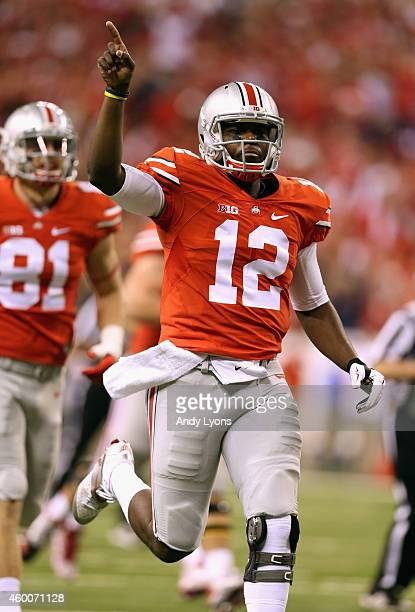 Quarterback Cardale Jones of the Ohio State Buckeyes celebrates a touchdown in the first quarter against the Wisconsin Badgers in the Big Ten...