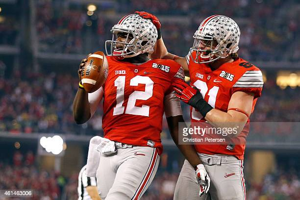Quarterback Cardale Jones of the Ohio State Buckeyes celebrates after scoring a one yard touchdown in the second quarter against the Oregon Ducks...