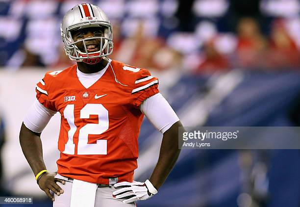 Quarterback Cardale Jones of the Ohio State Buckeyes smiles on the field during warm ups before playing against the Wisconsin Badgers in the Big Ten...