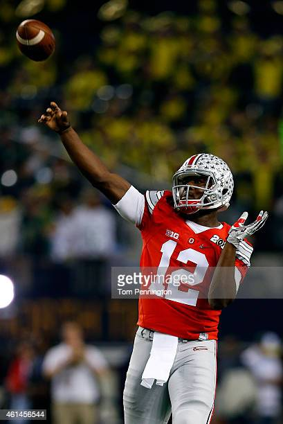 Quarterback Cardale Jones of the Ohio State Buckeyes throws a ball during warmups before taking on the Oregon Ducks in the College Football Playoff...