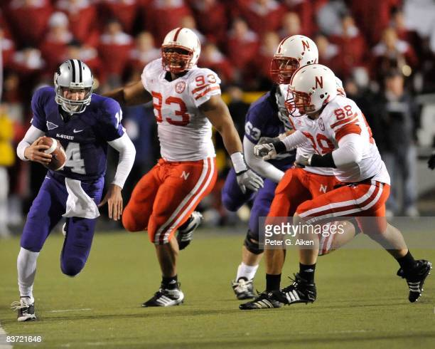 Quarterback Carson Coffman of the Kansas State Wildcats scrambles up the sideline against pressure from defenders Clayton Sievers and Ndamukong Suh...