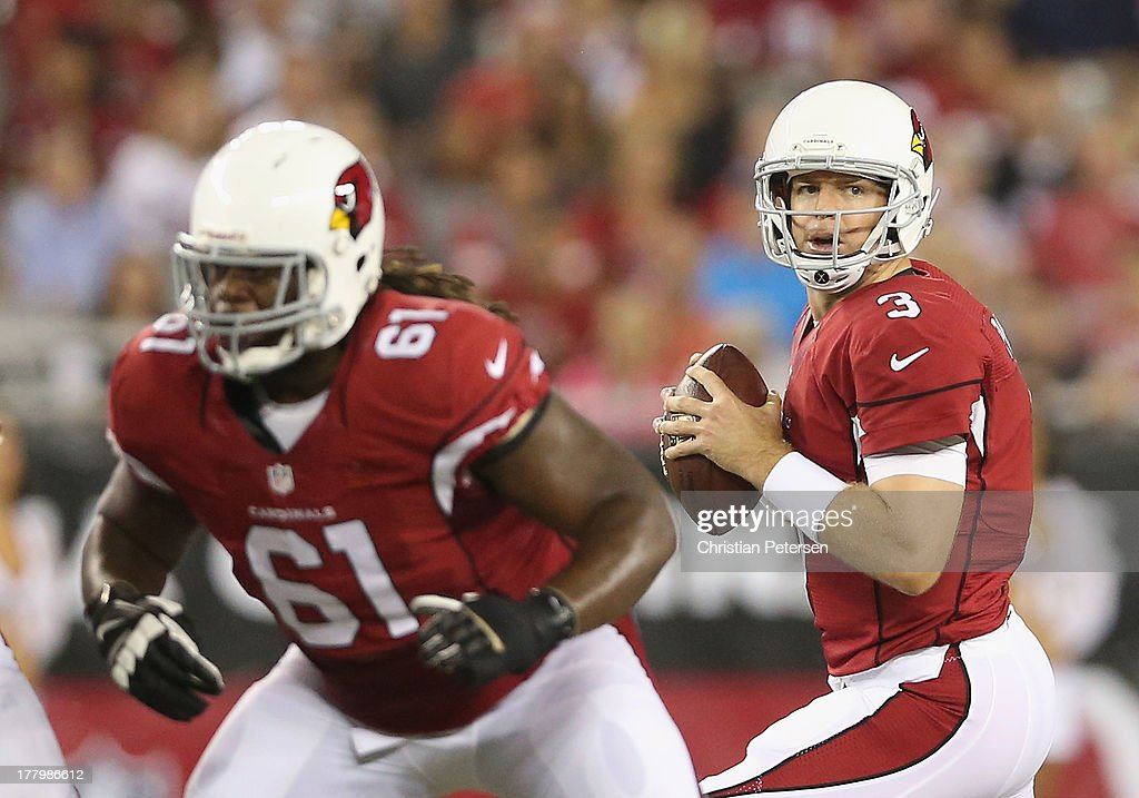 Quarterback Carson Palmer #3 of the Arizona Cardinals drops back to pass behind offensive guard Jonathan Cooper #61 during the preseason NFL game against the San Diego Chargers at the University of Phoenix Stadium on August 24, 2013 in Glendale, Arizona.