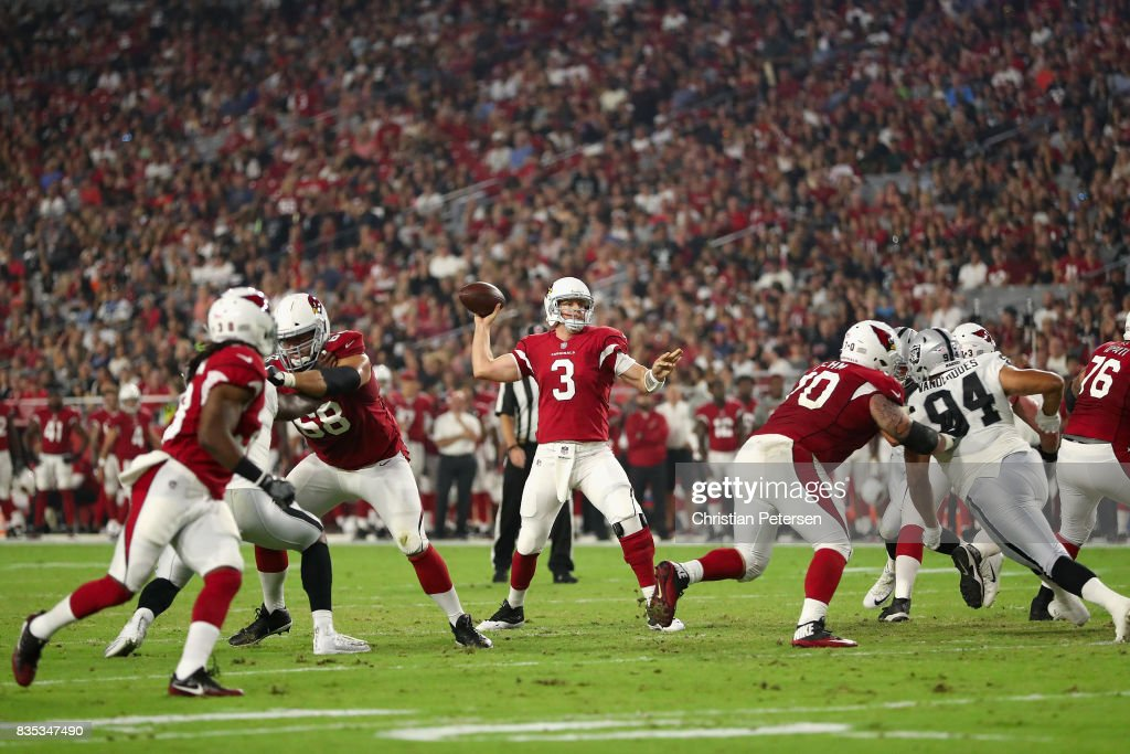 Quarterback Carson Palmer #3 of the Arizona Cardinals drops back to pass during the NFL game against the Oakland Raiders at the University of Phoenix Stadium on August 12, 2017 in Glendale, Arizona. The Cardinals defeated the Raiders 20-10.