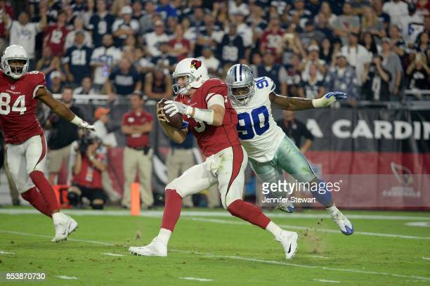 Quarterback Carson Palmer of the Arizona Cardinals is sacked by defensive end Demarcus Lawrence of the Dallas Cowboys during the second half of the...