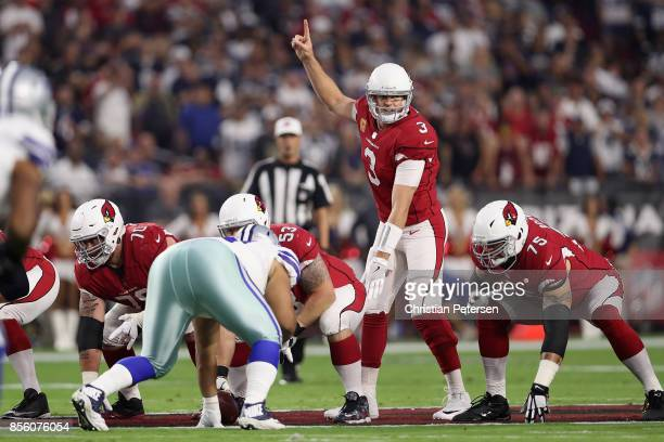 Quarterback Carson Palmer of the Arizona Cardinals prepares to snap the football during the NFL game against the Dallas Cowboys at the University of...