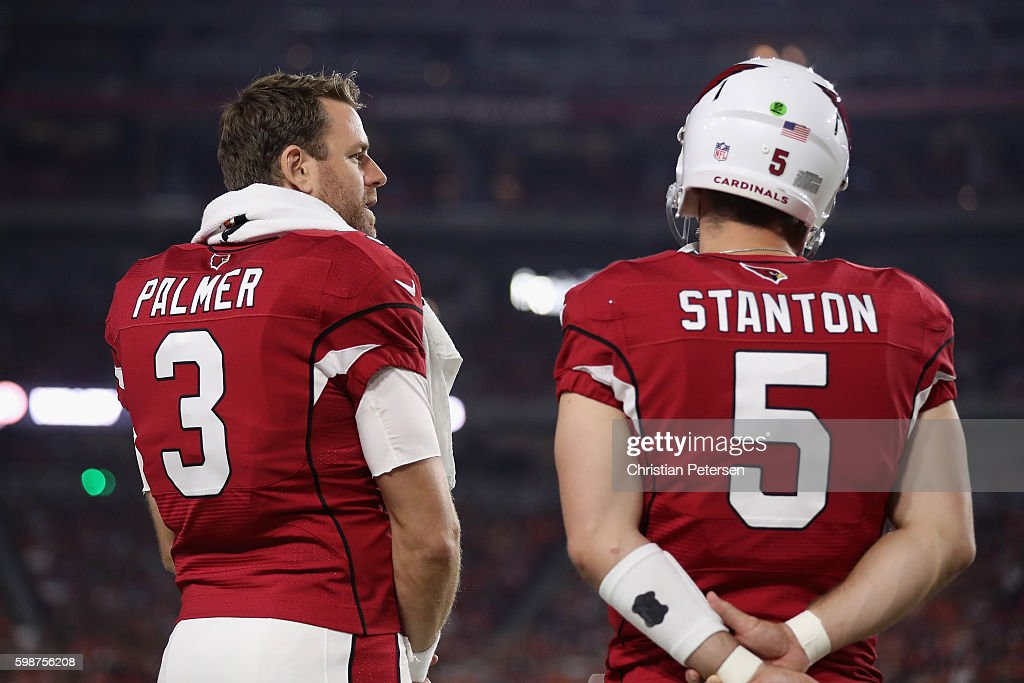 Quarterback Carson Palmer #3 of the Arizona Cardinals talks with Drew Stanton #5 during the preseaon NFL game against the Denver Broncos at the University of Phoenix Stadium on September 1, 2016 in Glendale, Arizona. The Cardinals defeated the Broncos 38-17.