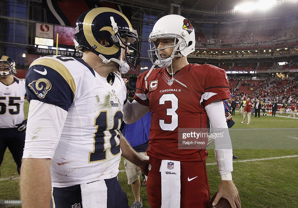 Quarterback Carson Palmer #3 of the Arizona Cardinals talks with Kellen Clemens #10 of the St Louis Rams following their NFL football game at University of Phoenix Stadium on December 8, 2013 in Glendale, Arizona. The Cardinals defeated the Rams 30-10.