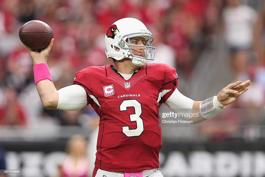 Quarterback Carson Palmer #3 of the Arizona Cardinals throws a pass during the first half of the NFL game against the Washington Redskins at the University of Phoenix Stadium on October 12, 2014 in Glendale, Arizona.
