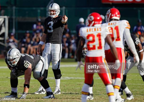 Quarterback Carson Palmer of the Oakland Raiders calls out the defense against cornerback Javier Arenas of the Kansas City Chiefs on October 23 2011...