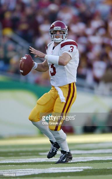 Quarterback Carson Palmer of the USC Trojans looks to pass during the game against the Oregon Ducks at Autzen Stadium on October 26, 2002 in Eugene,...