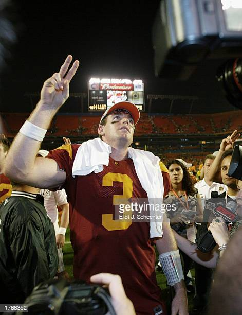 Quarterback Carson Palmer of USC, who was named MVP of the game, celebrates the victory over Iowa after the FedEx Orange Bowl on January 2, 2003 at...