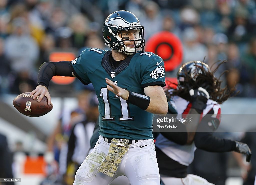 Quarterback Carson Wentz #11 of the Philadelphia Eagles attempts a pass during the fourth quarter against the Atlanta Falcons during a game at Lincoln Financial Field on November 13, 2016 in Philadelphia, Pennsylvania. The Eagles defeated the Falcons 24-15.