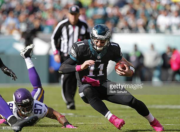 Quarterback Carson Wentz of the Philadelphia Eagles avoids Everson Griffen of the Minnesota Vikings as he runs for a first down during the second...