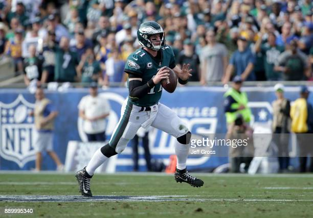Quarterback Carson Wentz of the Philadelphia Eagles carries the ball against the Los Angeles Rams at Los Angeles Memorial Coliseum on December 10...