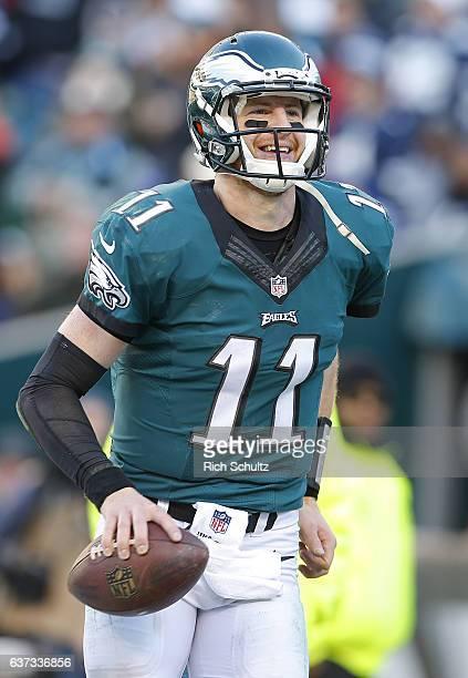 Quarterback Carson Wentz of the Philadelphia Eagles celebrates his touchdown pass against the Dallas Cowboys during the third quarter of a game at...