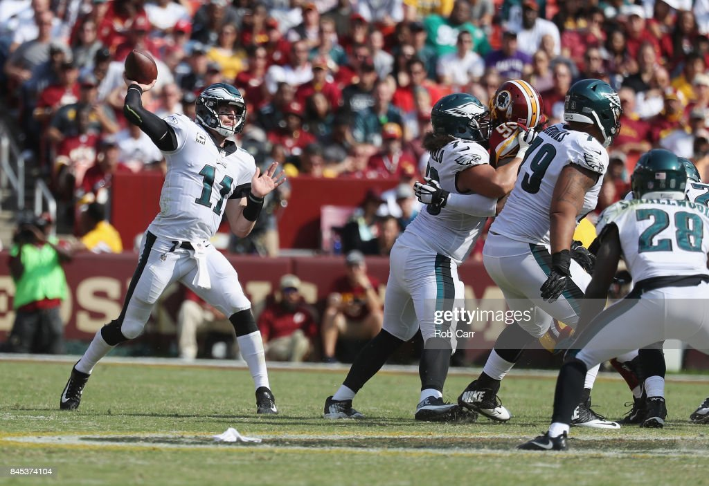 Quarterback Carson Wentz #11 of the Philadelphia Eagles completes a pass against the Washington Redskins in the fourth quarter at FedExField on September 10, 2017 in Landover, Maryland.