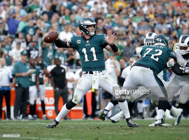 Quarterback Carson Wentz of the Philadelphia Eagles drops back to pass against the Los Angeles Rams at Los Angeles Memorial Coliseum on December 10...