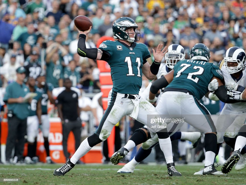 Quarterback Carson Wentz #11 of the Philadelphia Eagles drops back to pass against the Los Angeles Rams at Los Angeles Memorial Coliseum on December 10, 2017 in Los Angeles, California.