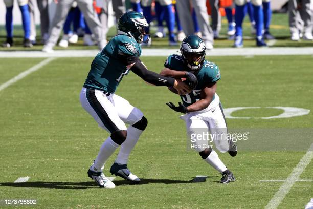Quarterback Carson Wentz of the Philadelphia Eagles hands the ball off to running back Boston Scott against the Los Angeles Rams at Lincoln Financial...