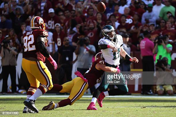 Quarterback Carson Wentz of the Philadelphia Eagles is hit by inside linebacker Will Compton of the Washington Redskins in the third quarter at...