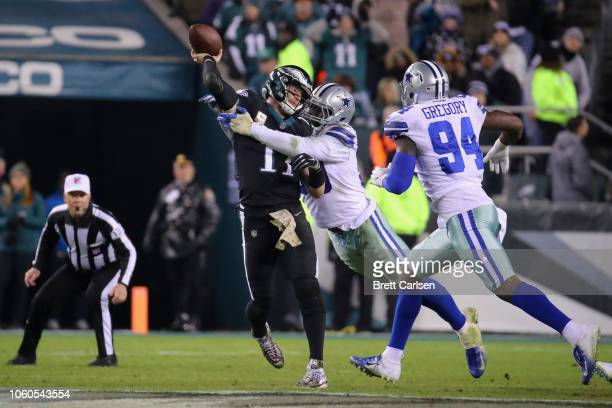 Quarterback Carson Wentz of the Philadelphia Eagles is hit while throwing the ball for an incomplete pass against the Dallas Cowboys during the...