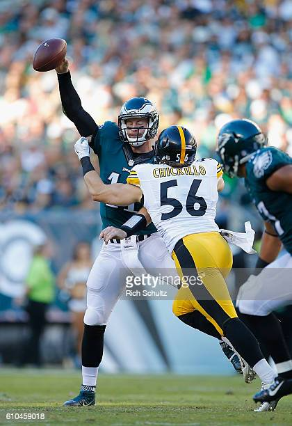 Quarterback Carson Wentz of the Philadelphia Eagles is pressured by Anthony Chickillo of the Pittsburgh Steelers at Lincoln Financial Field on...