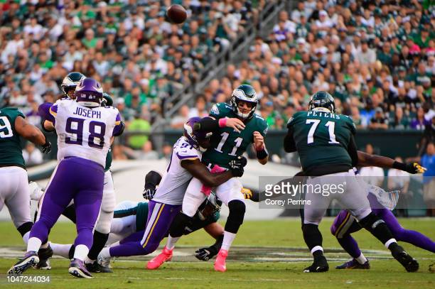 quarterback Carson Wentz of the Philadelphia Eagles is sacked by defensive end Stephen Weatherly of the Minnesota Vikings during the second quarter...