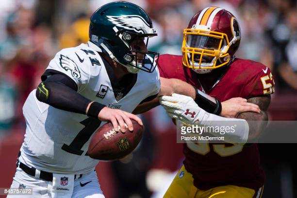 Quarterback Carson Wentz of the Philadelphia Eagles is tackled by Zach Brown of the Washington Redskins in the second quarter at FedExField on...