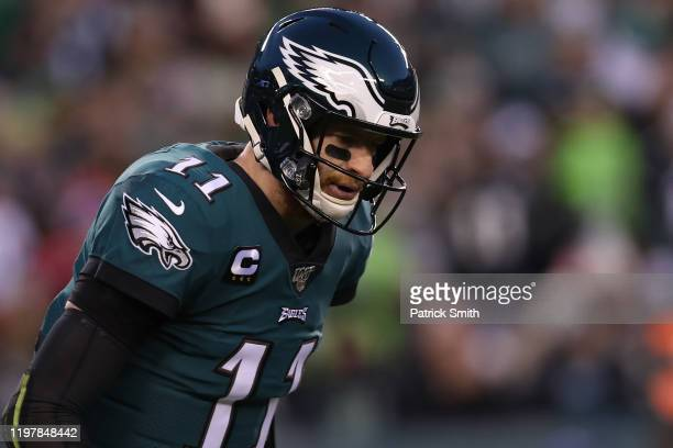 Quarterback Carson Wentz of the Philadelphia Eagles looks on against the Seattle Seahawks during their NFC Wild Card Playoff game at Lincoln...