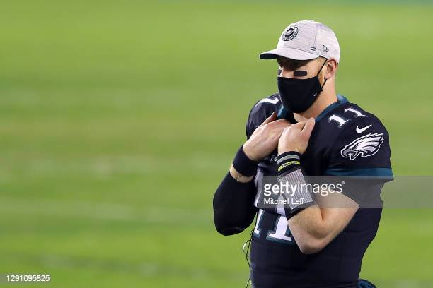 Quarterback Carson Wentz of the Philadelphia Eagles looks on from the bench in the first half against the New Orleans Saints at Lincoln Financial...