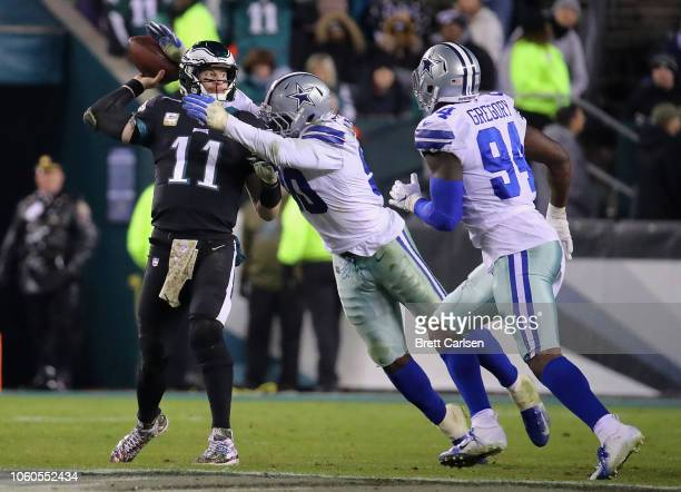 Quarterback Carson Wentz of the Philadelphia Eagles looks to pass against the Dallas Cowboys during the fourth quarter at Lincoln Financial Field on...