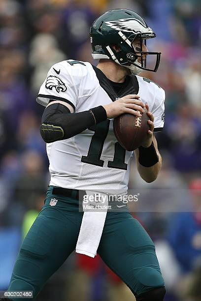Quarterback Carson Wentz of the Philadelphia Eagles looks to pass the ball against the Baltimore Ravens in the first quarter at MT Bank Stadium on...
