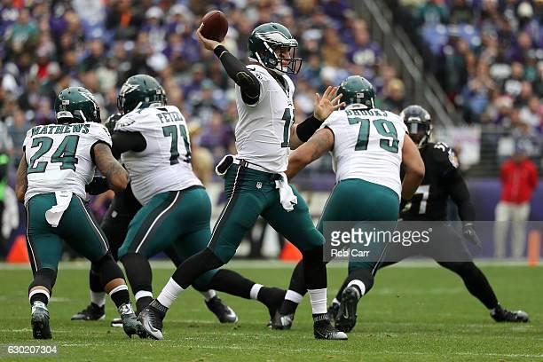 Quarterback Carson Wentz of the Philadelphia Eagles passes the ball while teammate guard Brandon Brooks blocks against the Baltimore Ravens in the...