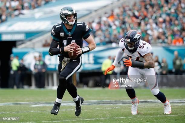 Quarterback Carson Wentz of the Philadelphia Eagles runs the ball against outside linebacker Shane Ray of the Denver Broncos during the first quarter...