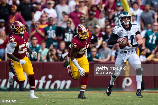 Quarterback Carson Wentz of the Philadelphia Eagles runs with the ball in the second half against the Washington Redskins at FedExField on September...