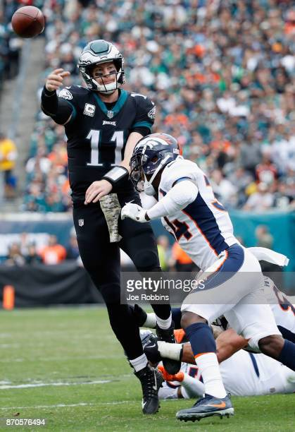 Quarterback Carson Wentz of the Philadelphia Eagles throws a pass against defensive back Will Parks of the Denver Broncos during the first quarter at...