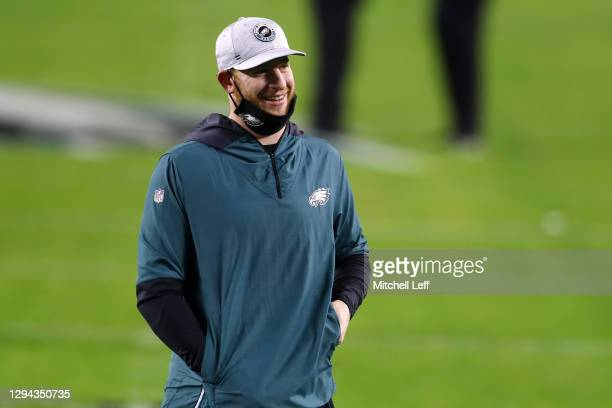Quarterback Carson Wentz of the Philadelphia Eagles walks on the field during warms up prior to the game against the Washington Football Team at...