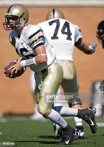 Quarterback Carson Williams of the Army Black Knights scrambles out of the pocket against the Wake Forest Demon Deacons during the Black Knights 2110...