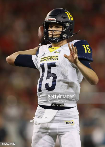Quarterback Case Cookus of the Northern Arizona Lumberjacks drops back to pass during the first half of the college football game against the Arizona...