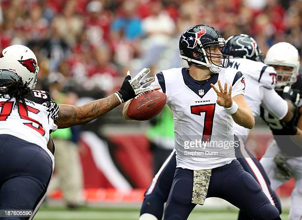 Quarterback Case Keenm of the Houston Texans is stripped of the ball by linebacker John Abraham of the Arizona Cardinals on the first play from...