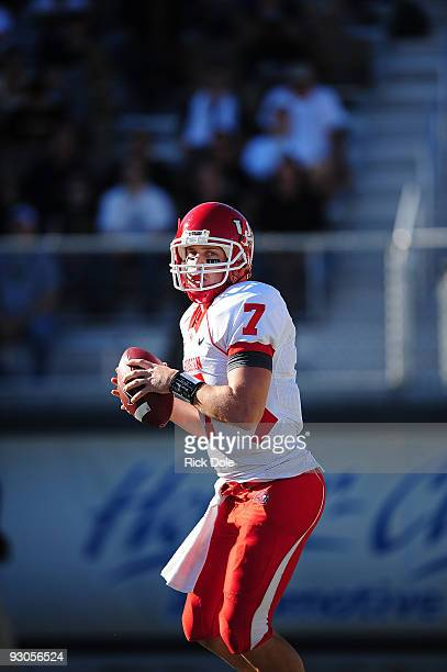 Quarterback Case Keenum, # 7 of the Houston Cougars, passing against the Central Florida Knights, at Bright House Networks Stadium on November 14,...
