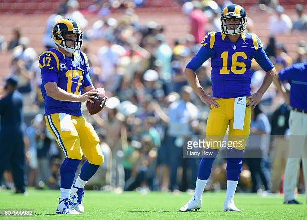 Quarterback Case Keenum and Jared Goff of the Los Angeles Rams warm up before their home opening NFL game against the Seattle Seahawks at Los Angeles...
