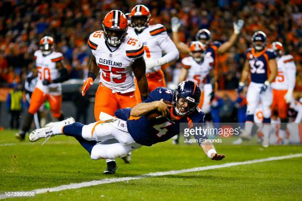 Quarterback Case Keenum of the Denver Broncos dives into the end zone for a first quarter touchdown against the Cleveland Browns at Broncos Stadium...