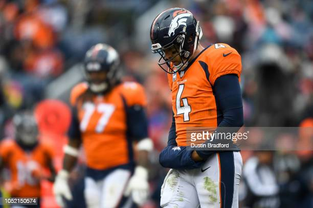 Quarterback Case Keenum of the Denver Broncos hangs his head as he walks on the field in the third quarter of a game against the Los Angeles Rams at...